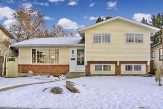 Photo 3: 164 Deermont Way SE in Calgary: Deer Ridge Detached for sale : MLS®# A1051814