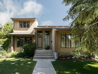 Photo 2: 36 PUMP HILL Mews SW in Calgary: Pump Hill House for sale : MLS®# C4128756