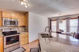 Photo 12: 67 EVERSYDE Circle SW in Calgary: Evergreen Detached for sale : MLS®# C4242781