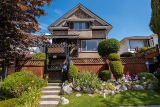 Photo 1: 557 E 56TH Avenue in Vancouver: South Vancouver House for sale (Vancouver East)  : MLS®# R2385991