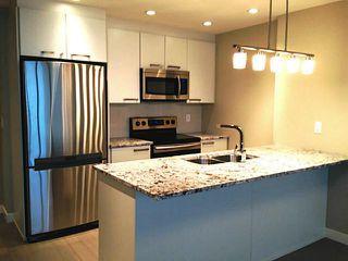 Photo 4: 1708 225 11 Avenue SE in CALGARY: Victoria Park Condo for sale (Calgary)  : MLS®# C3586999