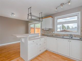 Photo 9: 504 LYSANDER Drive SE in Calgary: Ogden House for sale : MLS®# C4116400