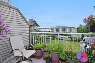 """Photo 11: 409 6359 198 Street in Langley: Willoughby Heights Condo for sale in """"The Rosewood"""" : MLS®# R2182917"""