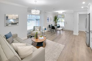 "Photo 1: 5196 CHAMBERS Street in Vancouver: Collingwood VE Townhouse for sale in ""Norquay Park Gardens"" (Vancouver East)  : MLS®# R2220073"