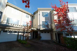 "Photo 1: 4 15450 101A Avenue in Surrey: Guildford Townhouse for sale in ""Canterbury"" (North Surrey)  : MLS®# R2315209"