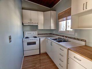 Photo 6: 60 Northwoods Village in Edmonton: Zone 27 House Half Duplex for sale : MLS®# E4146455