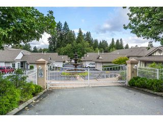 """Photo 1: 102 20655 88 Avenue in Langley: Walnut Grove Townhouse for sale in """"Twin Lakes"""" : MLS®# R2355122"""