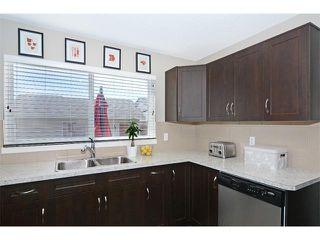 Photo 9: 63 SILVERADO PLAINS Manor SW in Calgary: Silverado House for sale : MLS®# C4015040