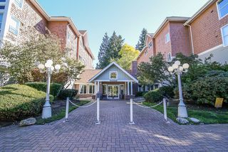"Photo 1: 212 9650 148 Street in Surrey: Guildford Condo for sale in ""Hartford Woods"" (North Surrey)  : MLS®# R2005610"