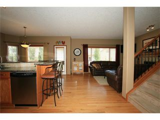 Photo 4: 18 WEST POINTE Manor: Cochrane House for sale : MLS®# C4072318