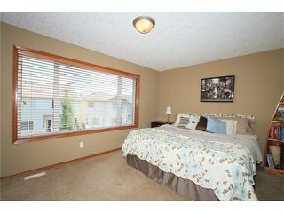Photo 21: 18 WEST POINTE Manor: Cochrane House for sale : MLS®# C4072318