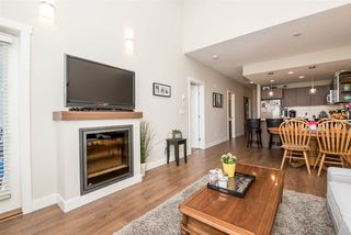 """Photo 6: 405 19936 56 Avenue in Langley: Langley City Condo for sale in """"BEARING POINTE"""" : MLS®# R2143916"""
