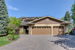 Photo 2: 120 LAKE PLACID Green SE in Calgary: Lake Bonavista House for sale : MLS®# C4120309