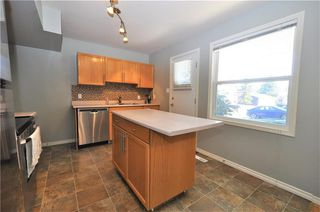 Photo 6: 414 REGAL Park NE in Calgary: Renfrew House for sale : MLS®# C4178136