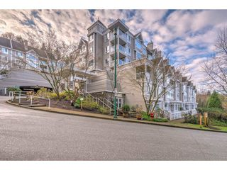 "Photo 1: 105 3033 TERRAVISTA Place in Port Moody: Port Moody Centre Condo for sale in ""THE GLENMORE"" : MLS®# R2334845"