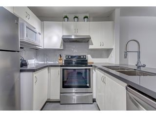 "Photo 4: 105 3033 TERRAVISTA Place in Port Moody: Port Moody Centre Condo for sale in ""THE GLENMORE"" : MLS®# R2334845"