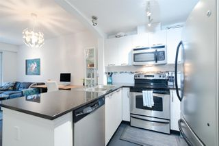 "Photo 3: 301 7418 BYRNEPARK Walk in Burnaby: South Slope Condo for sale in ""Green  - Summer"" (Burnaby South)  : MLS®# R2346354"