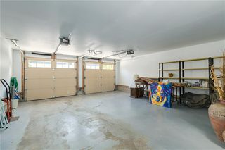 Photo 33: 230 SOMME Avenue SW in Calgary: Garrison Woods Row/Townhouse for sale : MLS®# C4261116