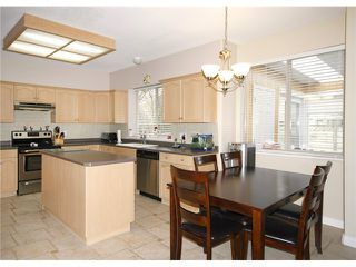 Photo 4: 2533 CONGO CR in Port Coquitlam: Riverwood House for sale : MLS®# V993476