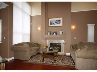 Photo 2: 2533 CONGO CR in Port Coquitlam: Riverwood House for sale : MLS®# V993476