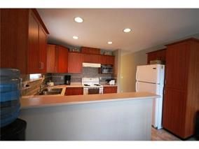 """Photo 7: 408 3000 RIVERBEND Drive in Coquitlam: Coquitlam East House for sale in """"RIVERBEND"""" : MLS®# R2060401"""