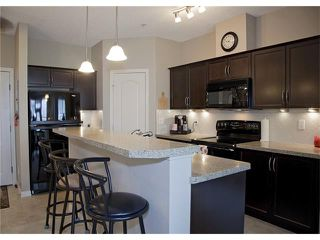 Photo 2: 221 1 Crystal Green Lane: Okotoks Condo for sale : MLS®# C4063698