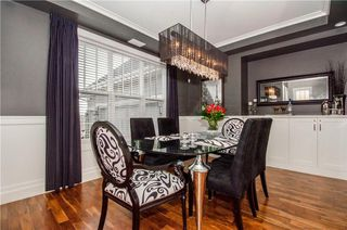 Photo 2: 202 FORTRESS Bay SW in Calgary: Springbank Hill House for sale : MLS®# C4098757