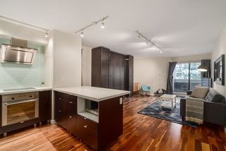 "Photo 1: 206 1545 E 2ND Avenue in Vancouver: Grandview VE Condo for sale in ""TALISHAN WOODS"" (Vancouver East)  : MLS®# R2231969"