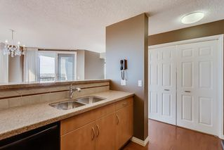 Photo 9: 2121 20 COACHWAY Road SW in Calgary: Coach Hill Apartment for sale : MLS®# C4209212