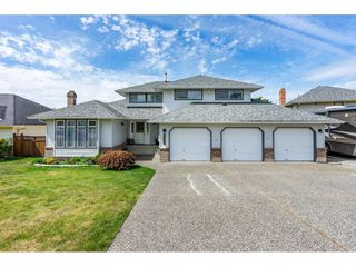 "Photo 1: 6495 180 Street in Surrey: Cloverdale BC House for sale in ""Orchard Ridge"" (Cloverdale)  : MLS®# R2396953"