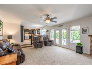 """Photo 10: 6495 180 Street in Surrey: Cloverdale BC House for sale in """"Orchard Ridge"""" (Cloverdale)  : MLS®# R2396953"""