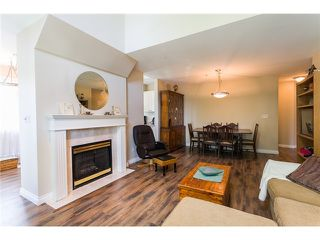 """Photo 4: 405 888 GAUTHIER Avenue in Coquitlam: Coquitlam West Condo for sale in """"LA BRITTANY"""" : MLS®# V1038984"""
