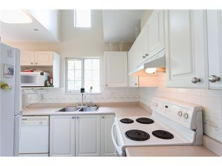 """Photo 7: 405 888 GAUTHIER Avenue in Coquitlam: Coquitlam West Condo for sale in """"LA BRITTANY"""" : MLS®# V1038984"""