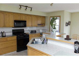 Photo 2: 11 WESTFALL Crescent in : Okotoks Residential Detached Single Family for sale : MLS®# C3619758