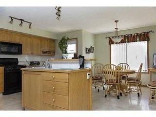 Photo 3: 11 WESTFALL Crescent in : Okotoks Residential Detached Single Family for sale : MLS®# C3619758