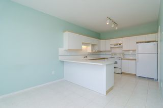 "Photo 15: 210 20680 56TH Avenue in Langley: Langley City Condo for sale in ""CASSOLA COURT"" : MLS®# F1422247"