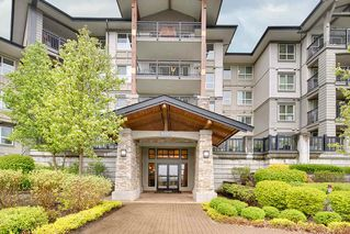 "Photo 1: 205 3050 DAYANEE SPRINGS BL in Coquitlam: Westwood Plateau Condo for sale in ""BRIDGES"" : MLS®# R2160778"