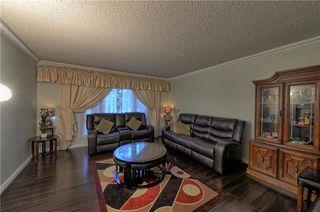 Photo 2: 67 CEDARDALE Crescent SW in Calgary: Cedarbrae House for sale : MLS®# C4190316