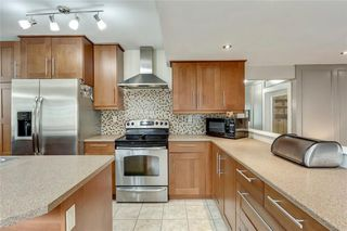 Photo 11: 7 WOODGREEN Crescent SW in Calgary: Woodlands Detached for sale : MLS®# C4245286