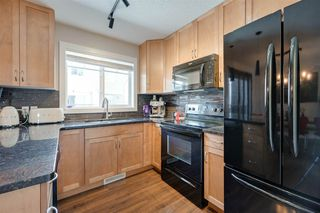 Photo 8: 29 675 ALBANY Way in Edmonton: Zone 27 Townhouse for sale : MLS®# E4190786