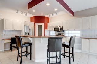Photo 8: 3207 Douglasdale Boulevard SE in Calgary: Douglasdale/Glen Detached for sale : MLS®# A1039628