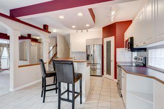 Photo 9: 3207 Douglasdale Boulevard SE in Calgary: Douglasdale/Glen Detached for sale : MLS®# A1039628