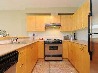 Photo 2: # 104 980 W 22ND AV in Vancouver: Cambie Condo for sale (Vancouver West)  : MLS®# V1019648