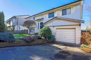 Photo 1: 6345 SUNDANCE Drive in Surrey: Cloverdale BC House for sale (Cloverdale)  : MLS®# R2037775