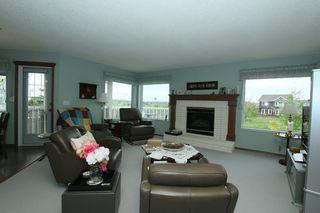 Photo 6: 76 Sandstone Ridge Crescent: Okotoks House for sale : MLS®# C4189236