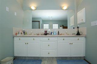 Photo 17: 76 Sandstone Ridge Crescent: Okotoks House for sale : MLS®# C4189236