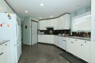 Photo 11: 76 Sandstone Ridge Crescent: Okotoks House for sale : MLS®# C4189236