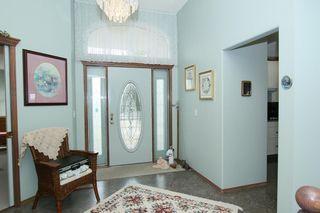 Photo 3: 76 Sandstone Ridge Crescent: Okotoks House for sale : MLS®# C4189236