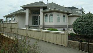 Photo 2: 76 Sandstone Ridge Crescent: Okotoks House for sale : MLS®# C4189236