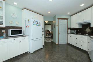 Photo 10: 76 Sandstone Ridge Crescent: Okotoks House for sale : MLS®# C4189236